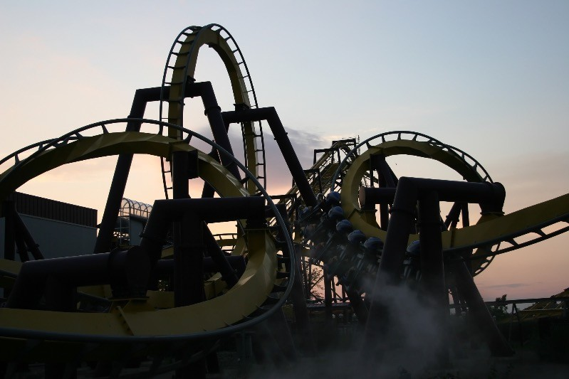 Riding the roller coaster during the setting of the sun.