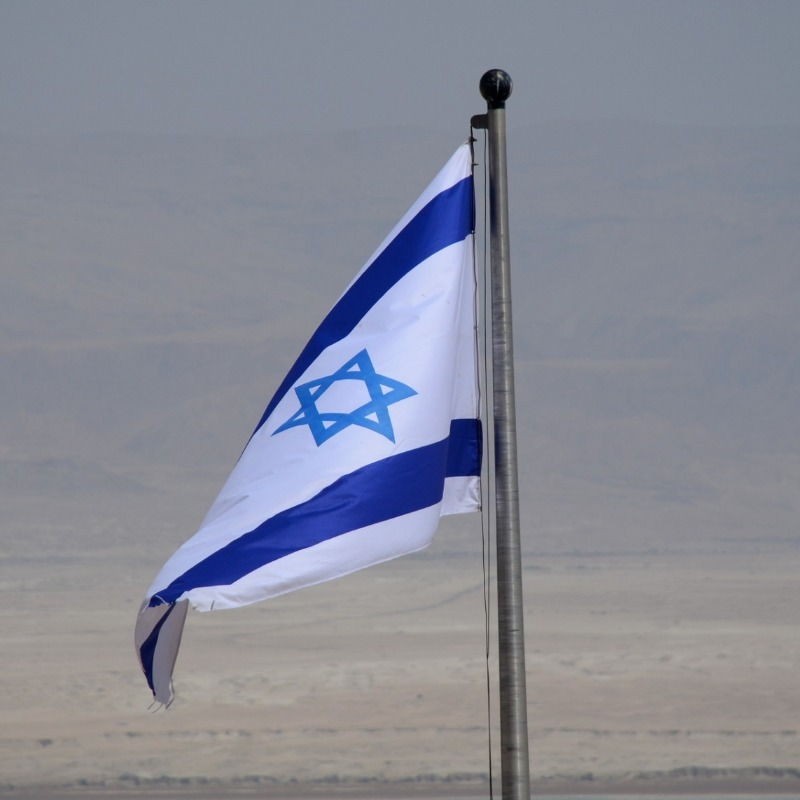 The full sized Israeli flag blowing in the wind