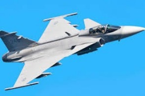 Fighter jet in the blue sky.