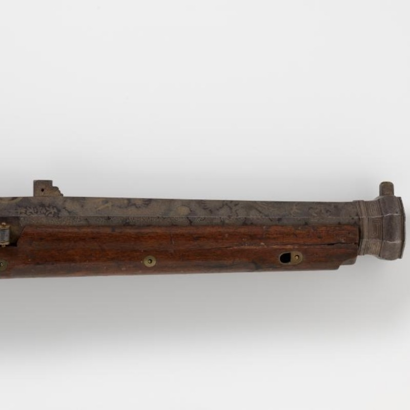 A matchlock hand cannon