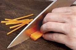 Slicing carrots julienne style.