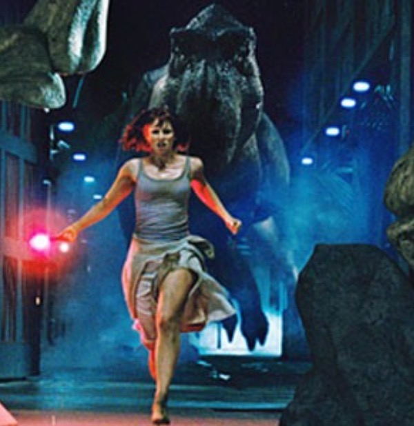 Running from a T-Rex in heels.