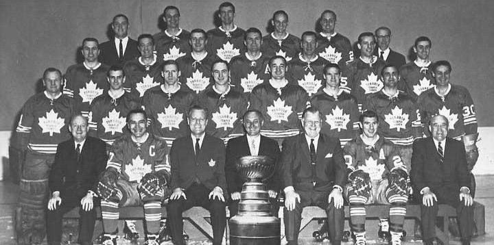The Leafs, 1967, Stanley Cup Champions pose with their prize.
