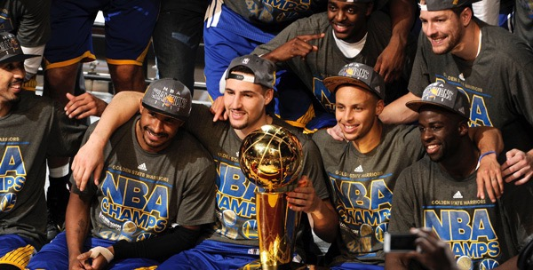 The Warriors pose for a picture after winning the NBA finals.