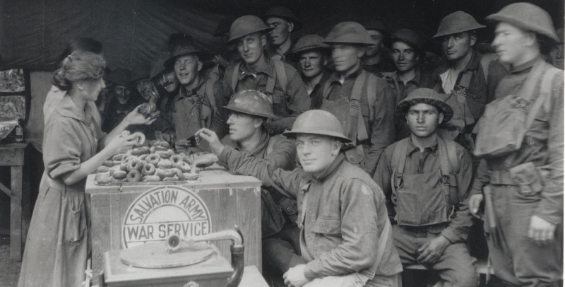 Soldiers scrambling for doughnuts.